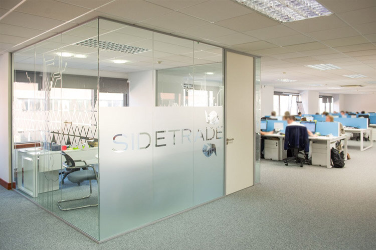 Glass partitions with frosted window film company logo for Window company