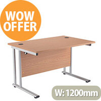 1200mm Wide Silver Leg Office Desk in Beech With Silver Cable Ports - Durable 25mm Desktop.  This extra strong double cantilever rectangular desk is a popular desk in offices.